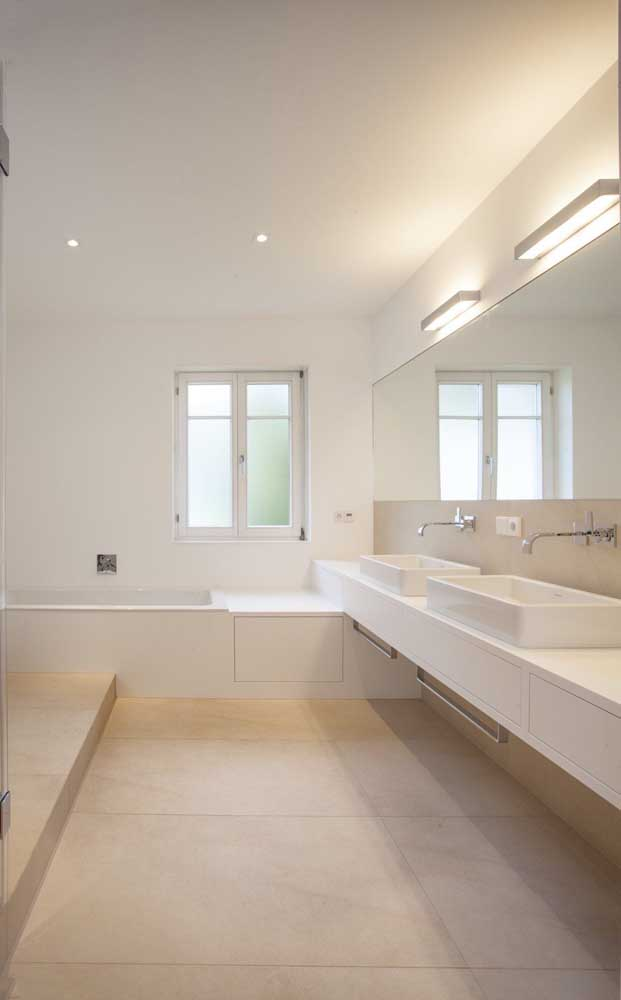 In this large bathroom, the ivory color breaks the predominant monotony of white