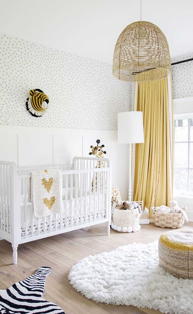 Modern children's room decorated with a color palette that combines white, yellow and ivory with small black details