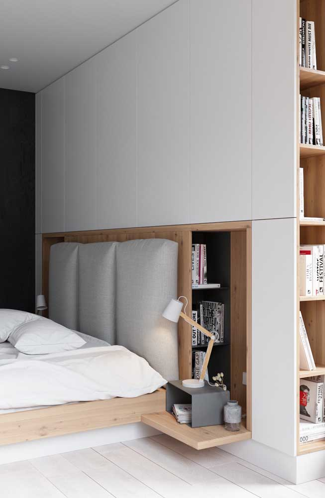In this small double room, the wall has built-in niches to save space
