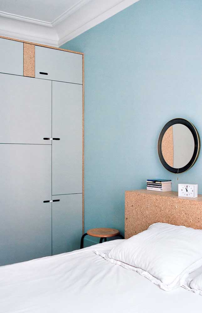 To escape traditional white, choose soft, neutral colors like the blue used on the wall