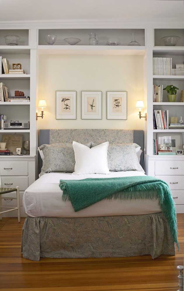 Small double bedroom with built-in bed between niches and shelves
