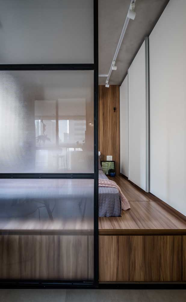 This small double bedroom has a wooden structure that elevates it from the floor, making it more cozy