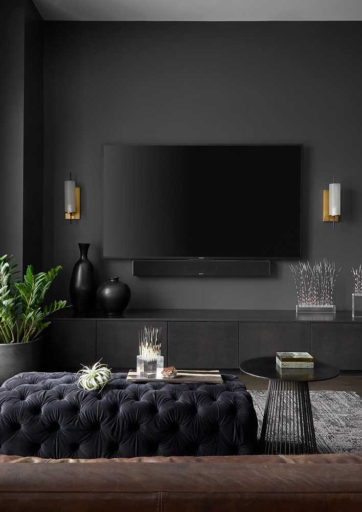 """Black and gray room. Notice that the black wall helps to """"camouflage"""" the TV and the rack"""