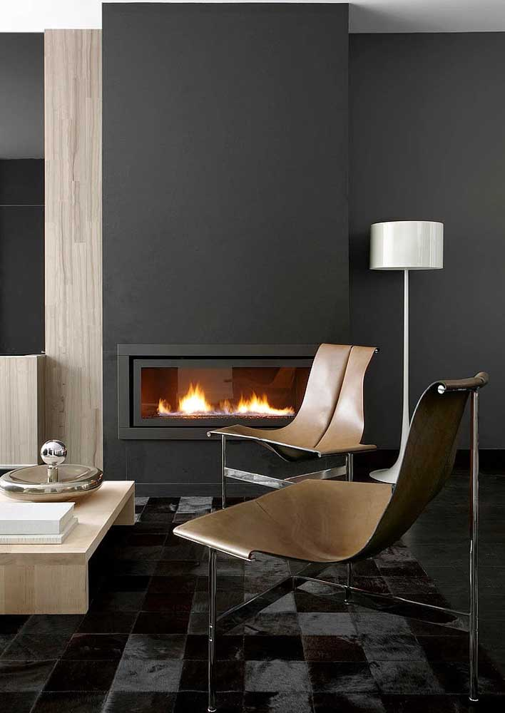 Black room with a warm touch of wood and leather details