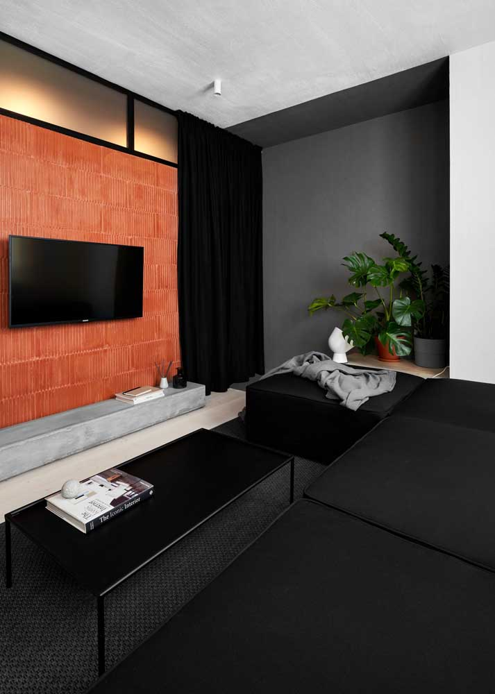 Small room can also have black. Here, color stands out in furniture