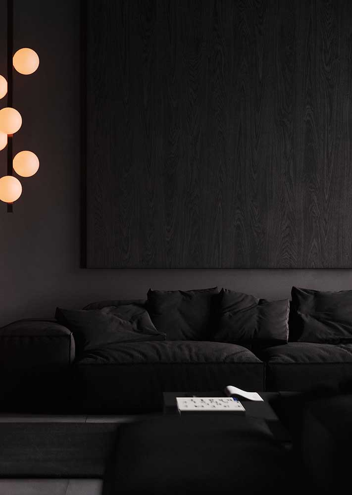 Here, the black room gains extra comfort with the use of yellow lights