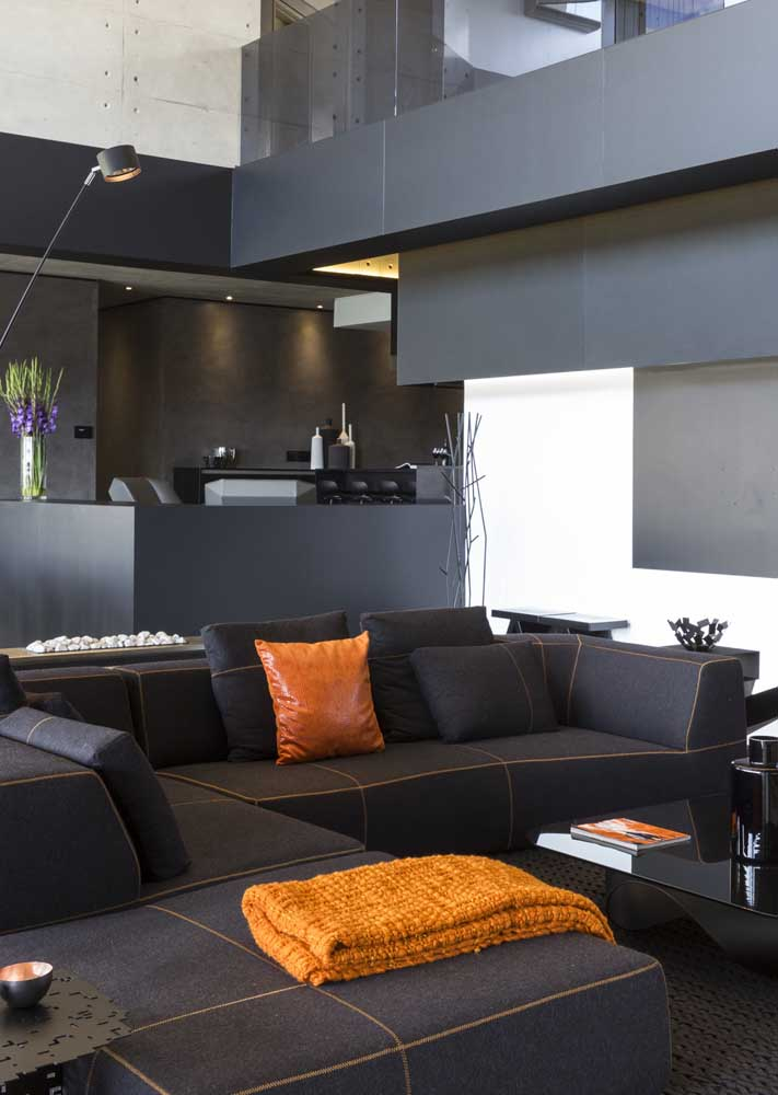 Seen from another angle, the black room reveals a relaxed mustard hue