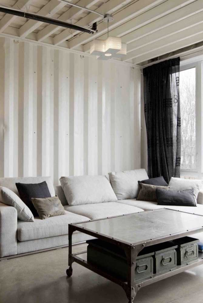 White sandwich tile for the ceiling and walls of this modern living room