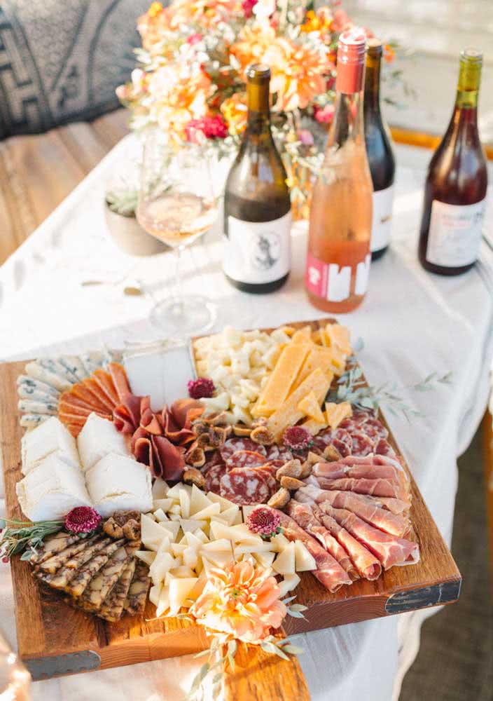 Chic cold cuts board accompanied by sparkling wine