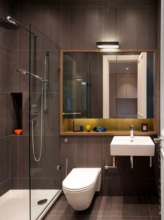 Dark bathroom with black finish and wooden support.