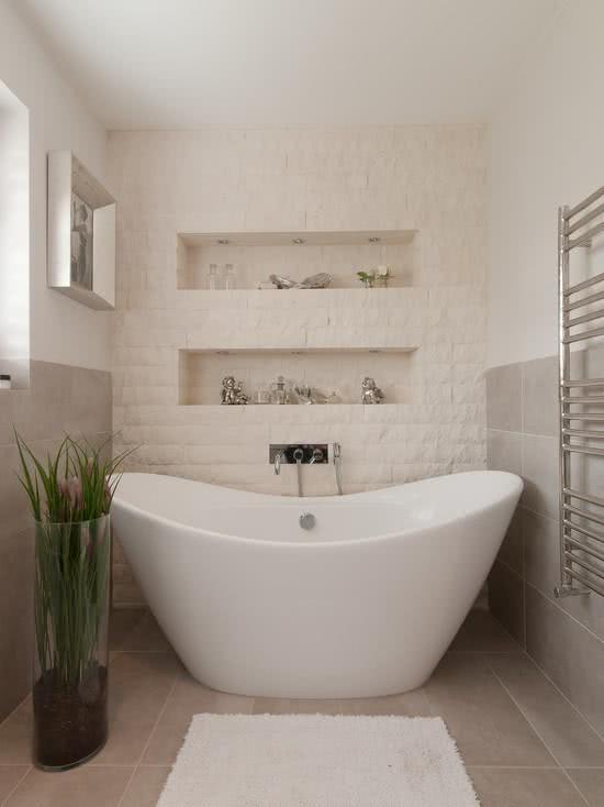 Wavy white bathtub, bathroom with white brick and wall