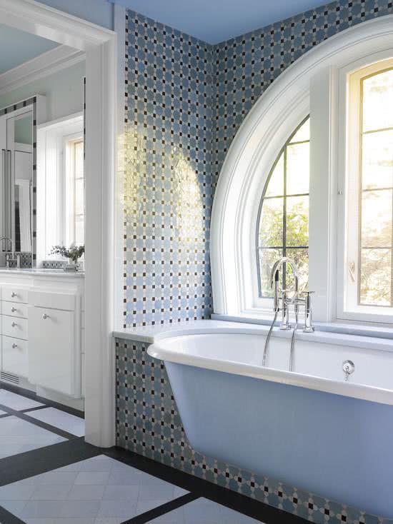 Blue bathtub embedded in masonry support