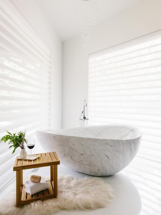 Clean bathroom with stone bathtub