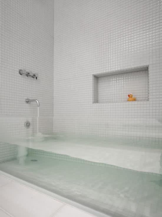 Bathroom with white tiles and acrylic tub