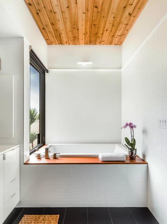 White square bathtub in the corner