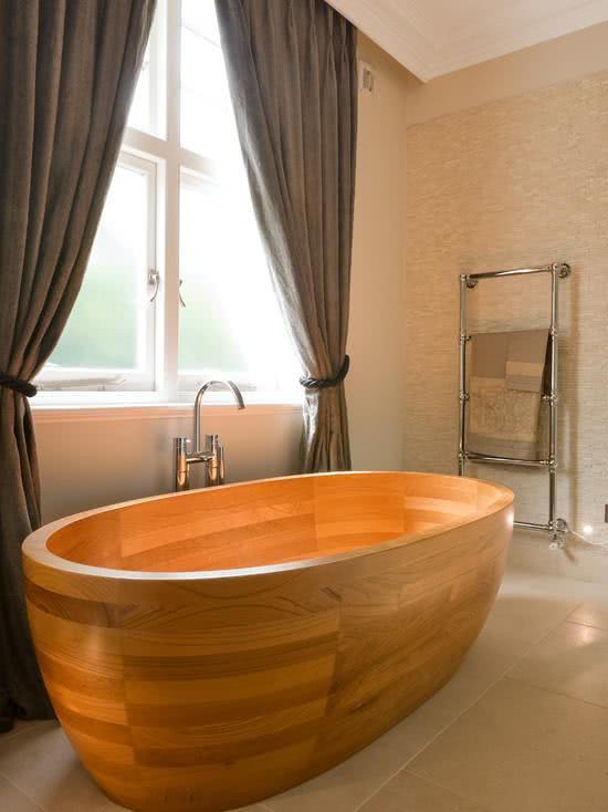 Bathtub with wood flooring