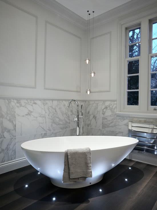 White bathtub, stone-clad wall