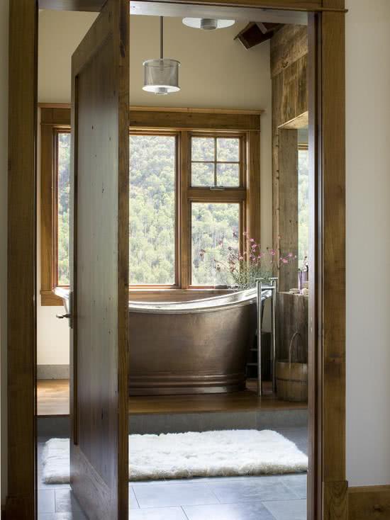 Copper bathtub in the window