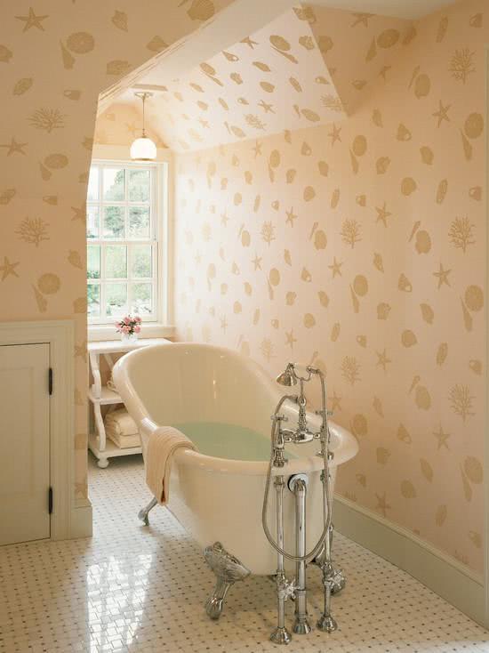 Bathtub with metallic feet, bathroom with wallpaper