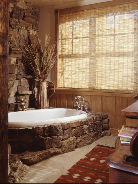 White bathtub with stone coating around