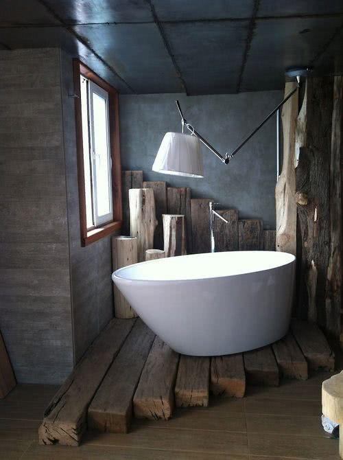White bathtub with wooden trunk supports