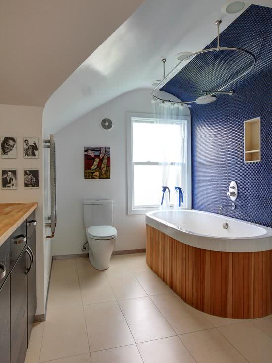 White bathtub with wooden stand