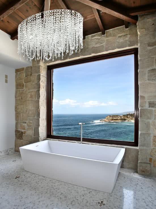 Bathroom with bathtub and elegant chandelier