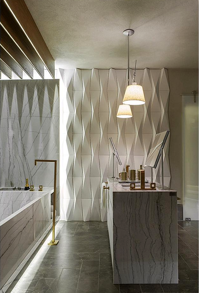 To convey elegance in the bathroom invest in countertops and sculpted bathtubs
