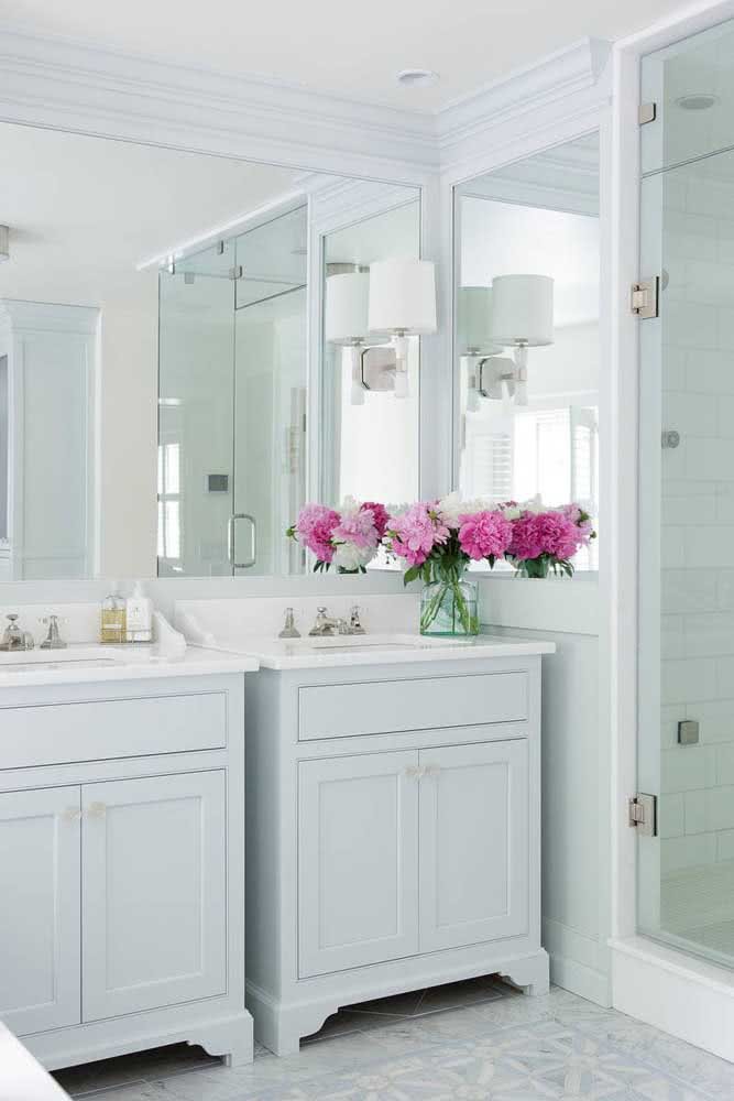 How to value a white bathroom?  With an arrangement of pink peonies