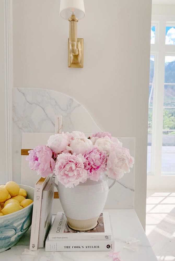 The ceramic vase brings even more sophistication to the arrangement of peonies