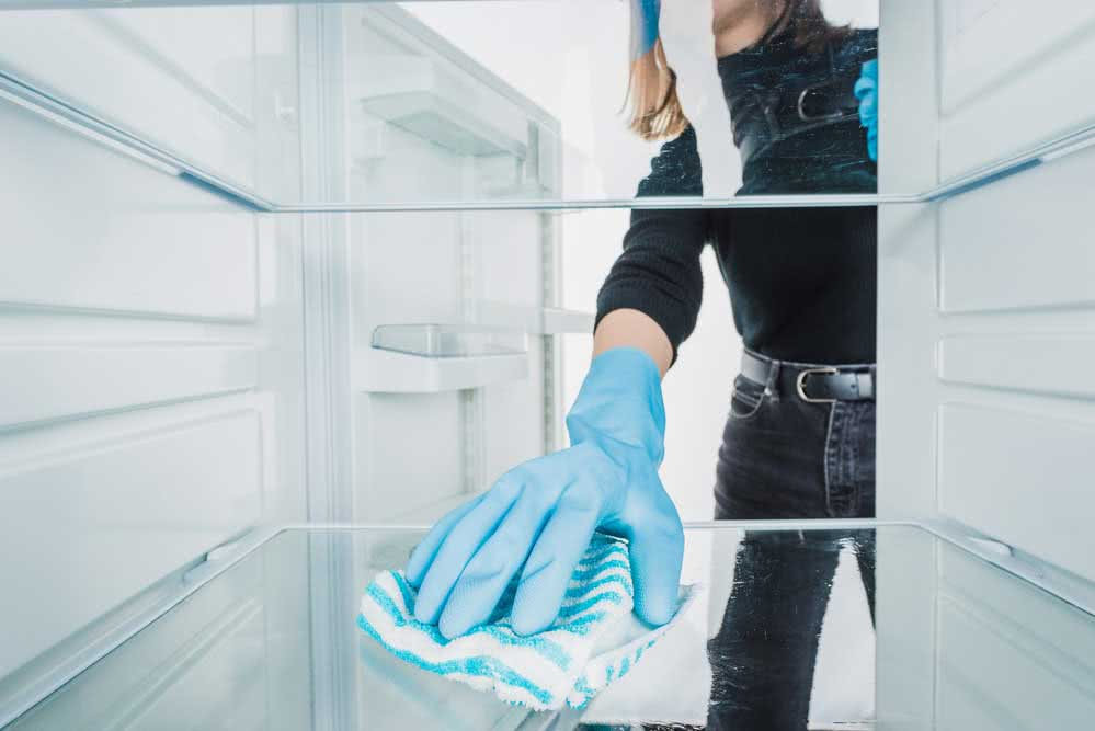 Removing odors from home appliances