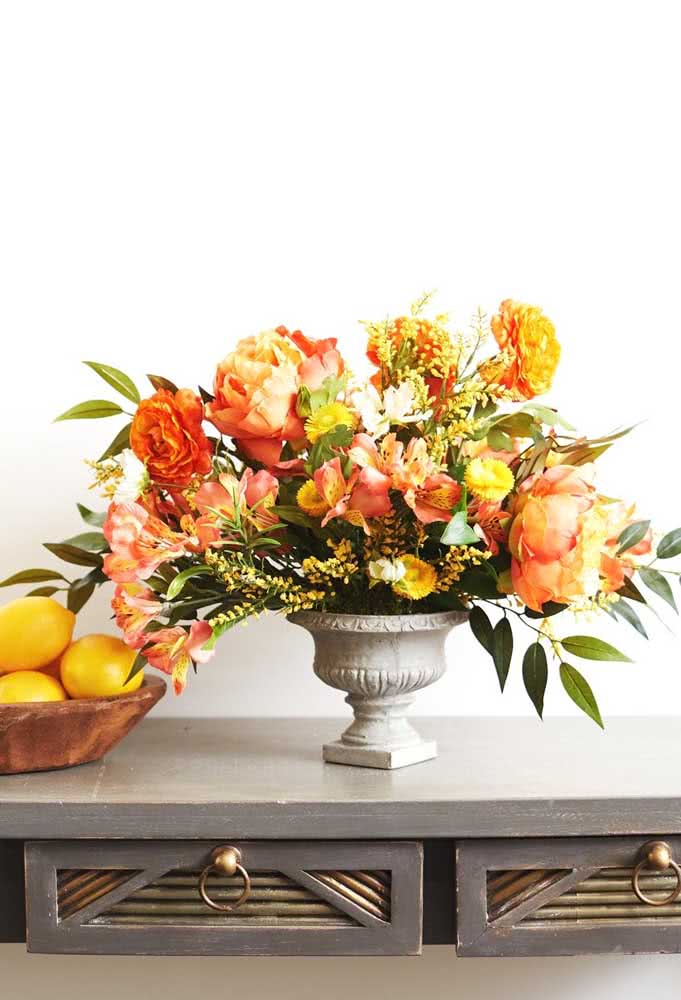 Astromelia and peonies in a warm and vibrant arrangement