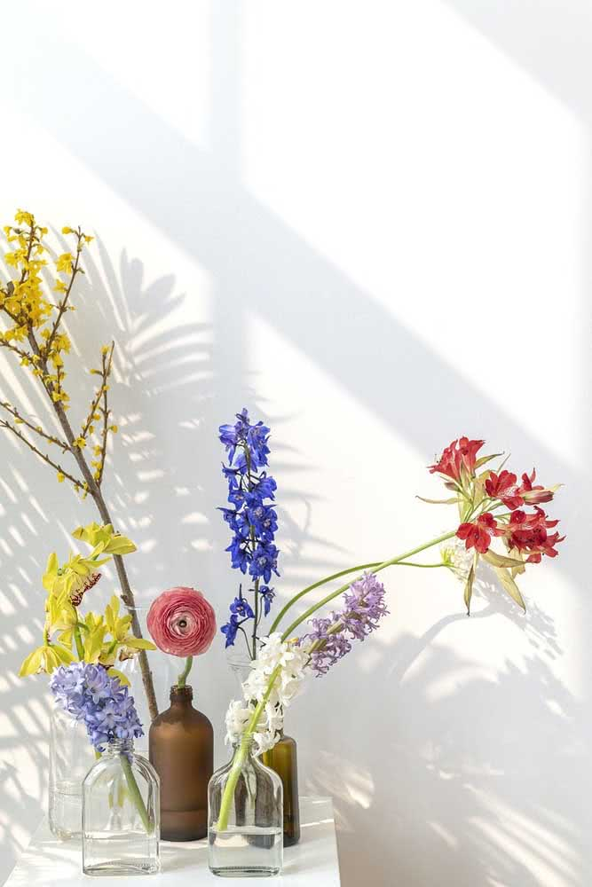 Astromelia and orchids form an exotic and colorful corner here