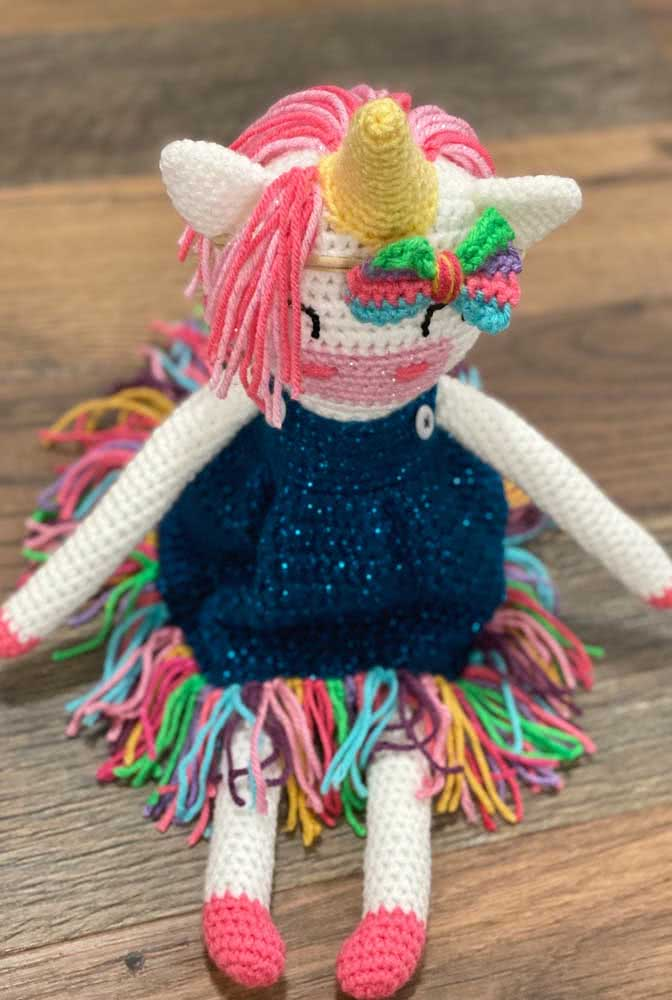 A little doll with unicorn ornament
