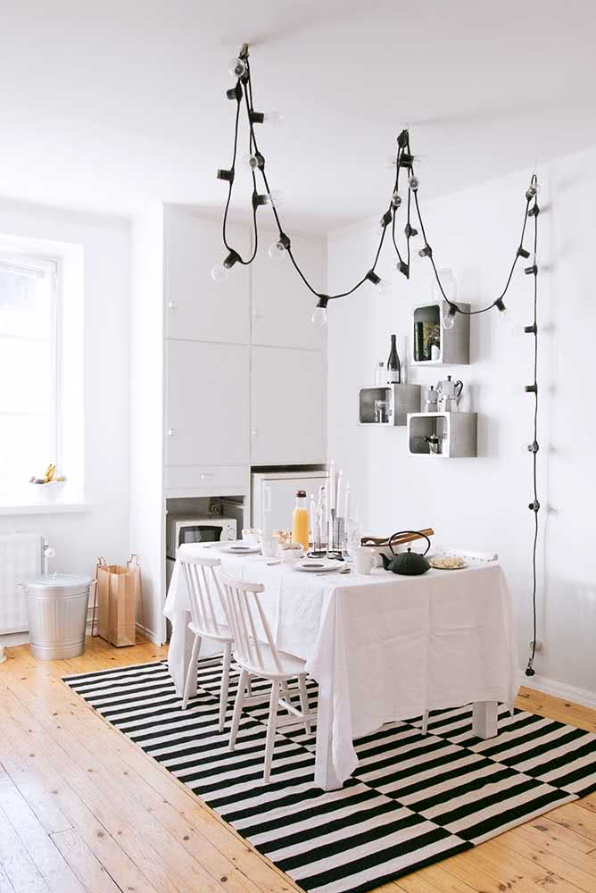 Instead of a light fixture, use a clothesline with lamps