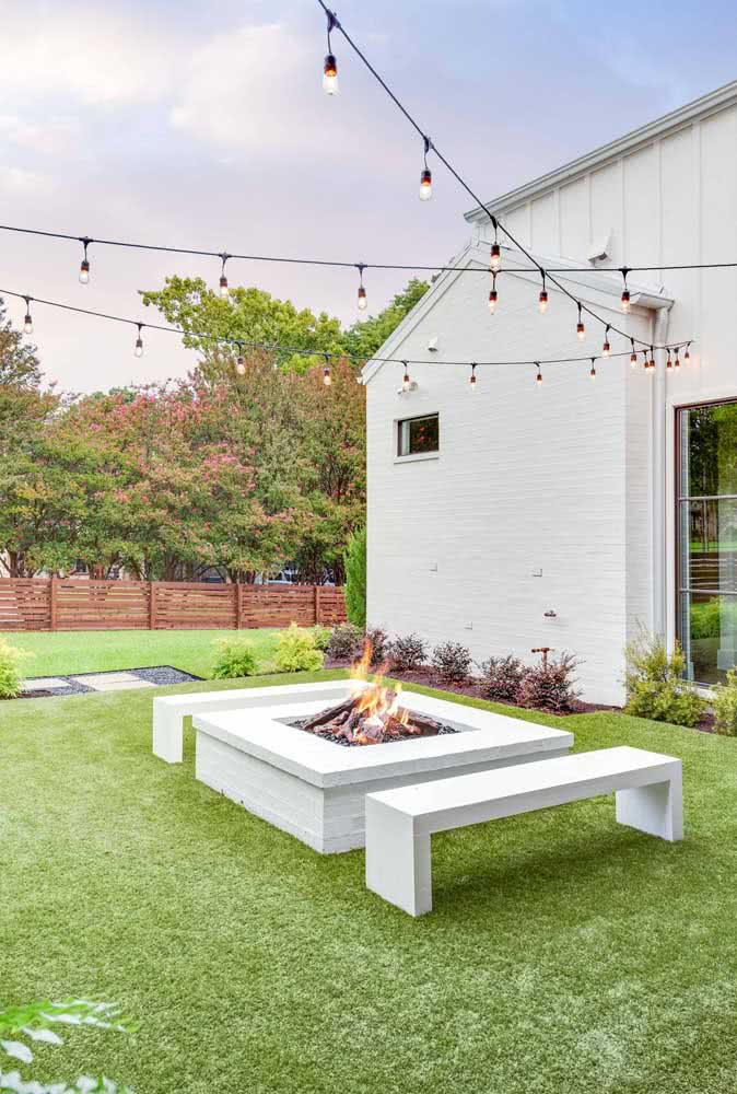 Clothesline with lamps in the garden with a fire